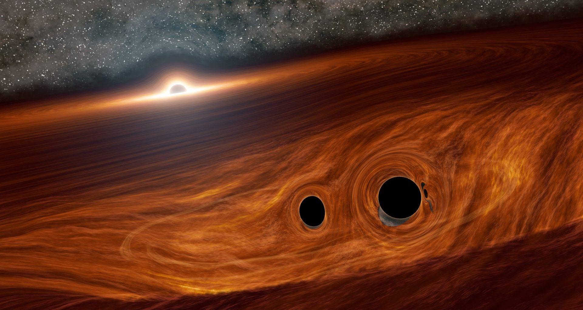Astrónomos observan un raro evento de fusión de tres agujeros negros supermasivos